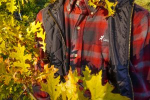 Camp Barnabas flannel with black vest in fall scene