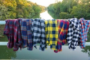 mixed colored glamping flannels hanging by the lake