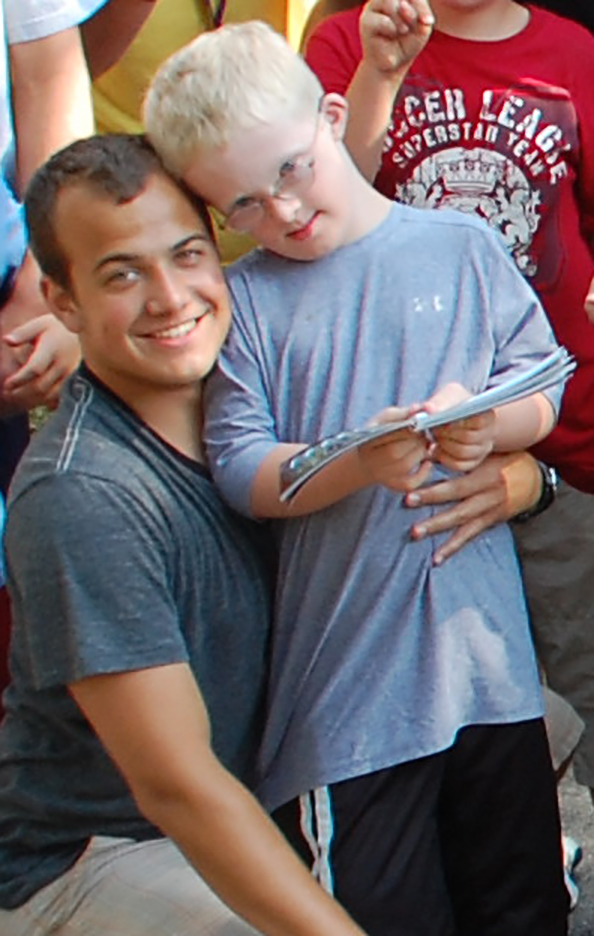 Jacob with his counselor in Summer 2010.